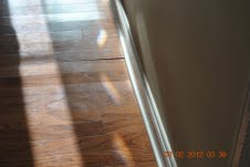 Delaminating engineered laminate due to mopping.